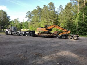 Tractor Trailer bringing in Dirt Mover Tree Removal Holly Springs, NC